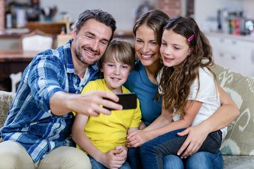 Happy family taking a selfie on mobile phone
