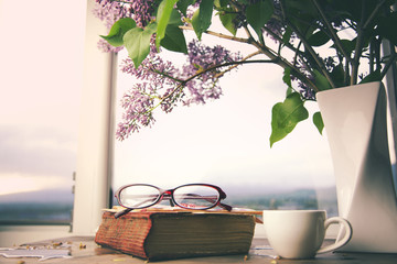 lilac, book and coffee  on table