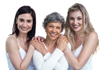 Women standing and holding hands on white background