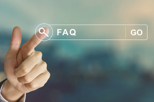 business hand clicking FAQ or Frequently asked questions button