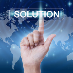 hand pressing solution sign on virtual screen. business concept