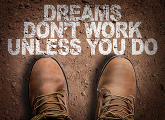Top View of Boot on the trail with the text: Dreams Don't Work Unless You Do