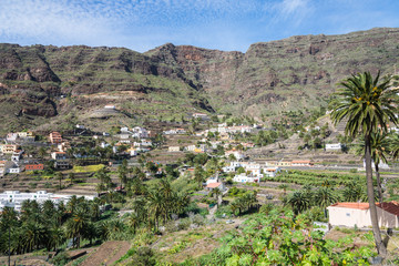 Villages and small towns in the Valle Gran Rey on la Gomera. Terraced fields and date palms is a typical landscape for the Valle Gran Rey, the beautiful canyon on the island La Gomera