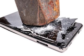 Hammer breaks a smartphone