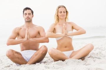Happy couple doing yoga