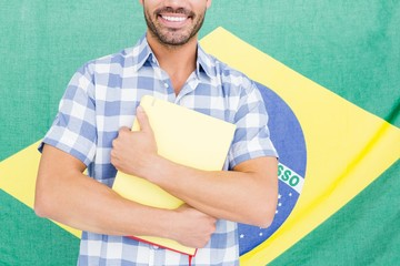 Mid section of happy young man holding folder