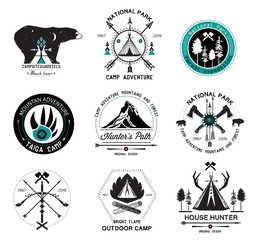 Set hunting labels. Outdoor camp logo. Wildlife sign. Indian wigwam logo. Crossed. Axes, bow, arrows logo.