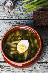 Nettle soup with eggs in the bowl