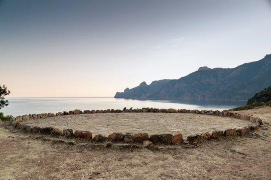 Circle of rocks on beach,  Girolata, Corsica, France