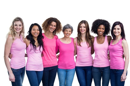 Happy multiethnic women standing together with arm around