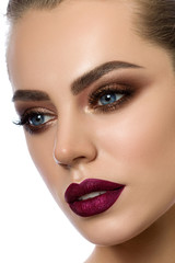 Close-up portrait of young woman with fashion makeup