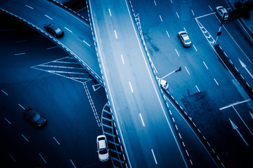 detail of traffic on chongqing caiyuanba overpass,blue toned image.