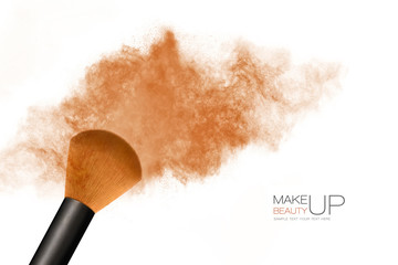 Makeup concept. Cosmetic brush with bronzing powder explosion