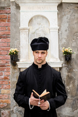 young priest in venice