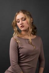 Beautiful elegant woman on gray background
