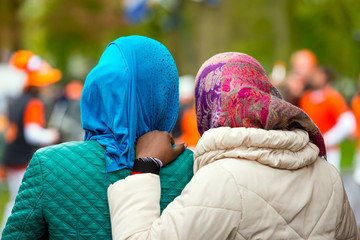 Two black women with headscarves