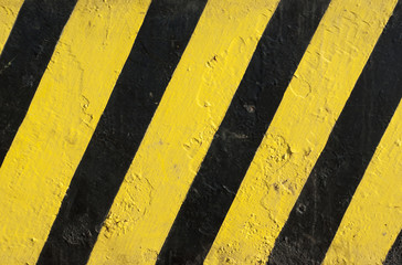 black and yellow painted caution sign metal texture