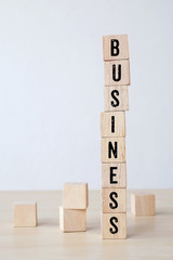 Business word on wooden cubes background