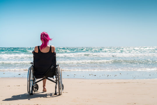Disabled woman in the wheelchair