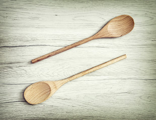 Two wooden spoons on the white background, kitchen equipment
