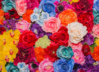 Beautiful multicolored artificial flowers background.