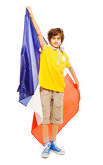 Young boy standing with French flag
