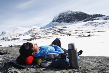 Woman resting in mountains