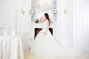 Portrait of beautiful bride. Wedding decoration. Luxurious light interior
