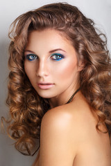 Blue beauty fashion make-up.Beautiful young model with bright make-up and manicure