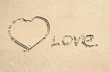 inscription love on the sand
