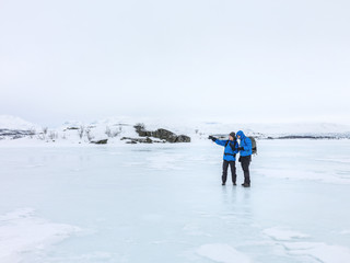 Men standing on ice