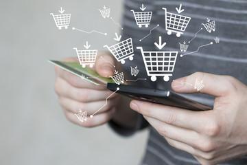 Businessman push button shopping cart online phone credit card