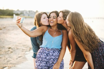 Group of young women taking selfie on beach