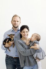 Parents with baby girl and dog