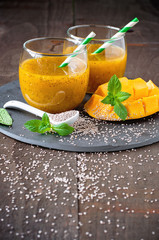 Mango juice with chia seeds, tropical drink detox and fresh fruit, selective focus