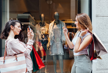 Two women making photo after shopping