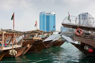 Abu Dhabi buildings skyline with old fishing boats