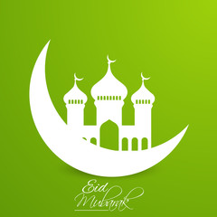 nice and beautiful vector abstract for Eid Mubarak with nice and beautiful moon and mosque illustration in a green background.