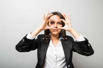 business woman looking through the hands of binoculars
