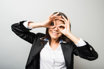 business woman looking through the hands of binoculars