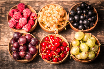 Fresh summer berries , wooden background, healthy food.