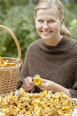 Smiling woman clearing chanterelles