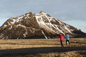Men jogging in mountains