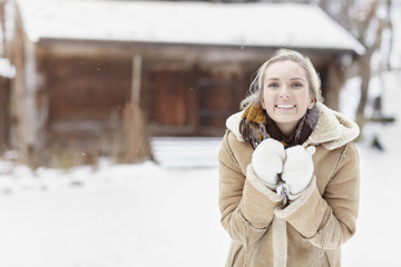 Smiling young woman at winter