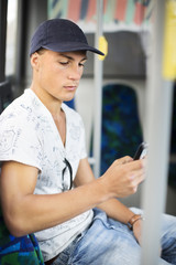 Teenage boy sitting in bus