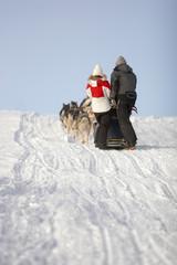 Couple on dog sledge