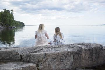 Teenage girls sitting at sea