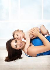 Joyful mother play with son