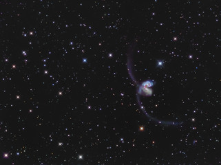 Real interacting galaxies called Antennae galaxies in the constellation Corvus taken through medium focal length telescope