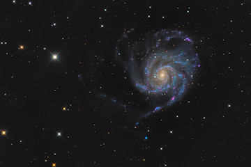Large spiral galaxy Messier 101 or Pinwheel galaxy in the constellation Ursa Major taken with CCD camera and medium focal length telescope